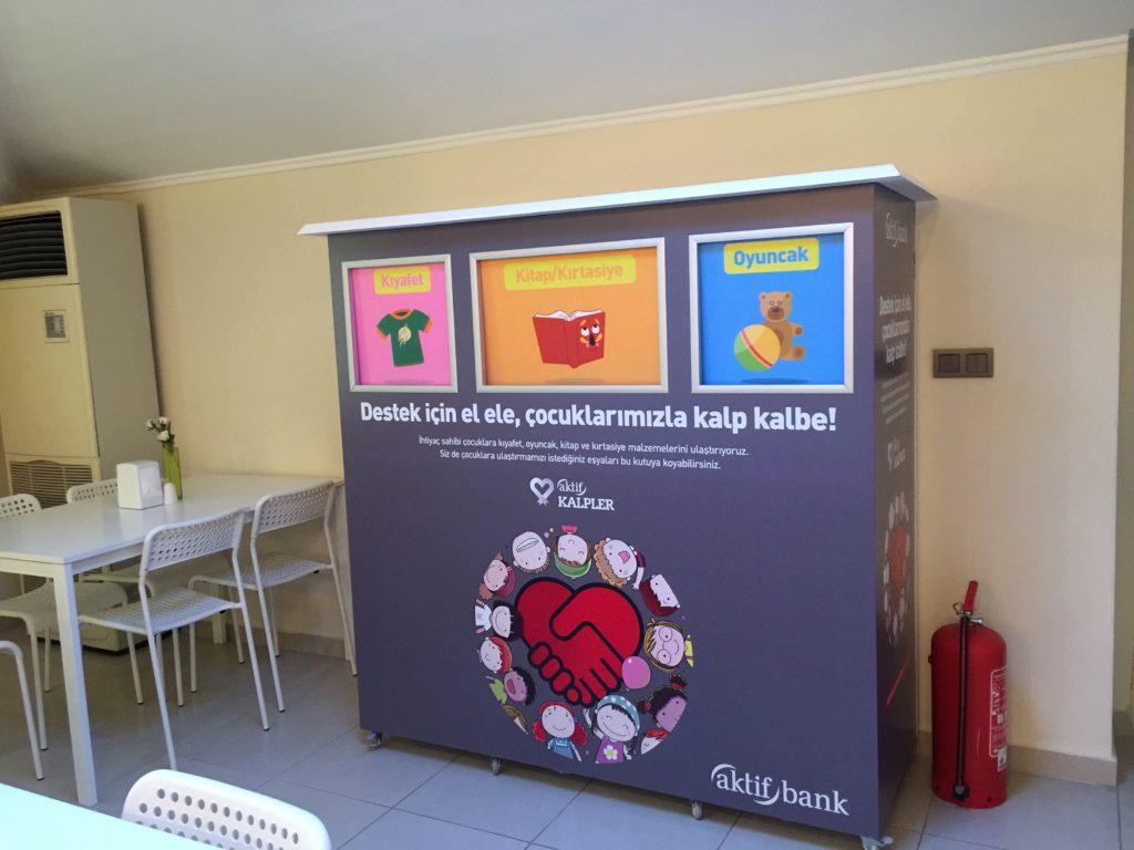 aktifbank giysi kumbarası revo reklam tuzla